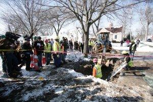 Workers repairing lead pipes in Flint